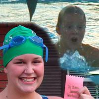 Daniel and Becca swim in the championship